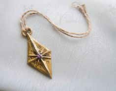 Amulet of The Nine prop replica ES by NeehellinsRealm on Etsy, $20.00