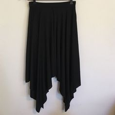 Zara Black Asymmetrical Skirt Elegant black asymmetrical skirt from Zara. Side zip closure. Raw edge hem. Excellent condition. Zara Skirts Midi