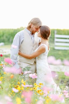 Sweet #wedding #photo in a field of wildflowers. Perfect for spring!