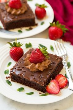 Chocolate Sheet Cake on Plate with Strawberries and mint garnish