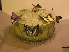 """Covered in buttercream.  Butterflies made with color flow icing.  make butterflies """"pop"""", made each wing separately, let them harden. Then, folded a piece of cardstock, lined with press n seal, piped body in the crease, place wings on either side. used triangle-shaped make-up applicators under the cardstock to prop up wings. When the bodies dried, """"glued"""" them to a plastic dowel with icing,stuck them in cake so that butterflies didn't touch the buttercream."""