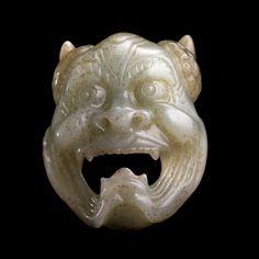 Jade demon mask. China, Tang dynasty (AD 618-906) or later.