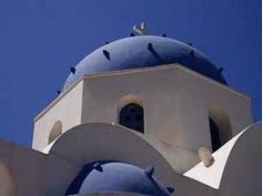 Guaranteed movie moments amidst the trademark blue and white structures of this famous Greek island