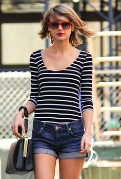 Taylor Swift in stripes and that purse I love.
