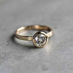 This sparkling 14k gold moissanite ring: