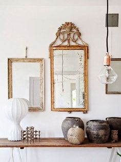 bare bulb light, vintage mirrors and ceramic jugs. / sfgirlbybay
