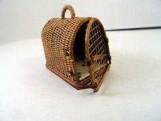 "HAND WOVEN DOG CARRIER WITH ADORABLE HINGED DOOR.. ARCH TOP, WOVEN HANDLE.. BUCKLES AS LATCHES..  LINED WITH DOG PAW PRINT. WOOD BASE... PERFECTLY MADE~~ 1 1/4"" tall 1 1/2"" deep.. 1"" wide"