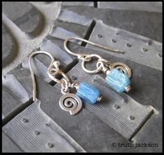 Ancient Roman glass beads, Israeli sterling silver swirl charms are suspended from a sterling silver ring. Sterling earwires. $24 truthjackson.com