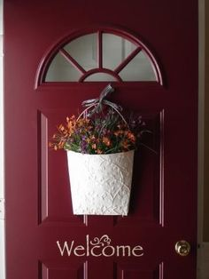 Our new front door will look like this..even been thinking of painting it this color! I really like the welcome lettering in the middle! http://lizmyers.uppercaseliving.net