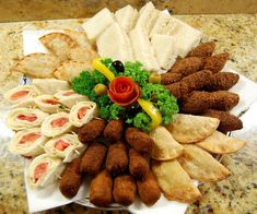 Typical Dominican Appetizer Platter! -- (Clockwise from Top Center: Mini-Sandwiches, Quipes, Empanadas, Croquettes, Roll-ups, Pastelitos!)