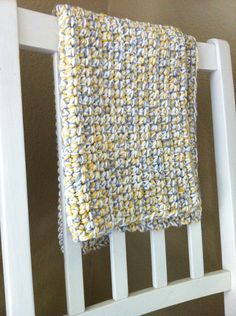 yellow crochet baby blanket: - big hook, 3 soft yarns (varying weights are fine), do entire blanket working in single crochet to size you want
