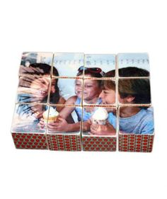 """Constructed of wooden blocks, this fun photo gift does double duty as household décor and a coffee table game. Select up to six shots, so each side of the """"puzzle"""" features a different family photo."""