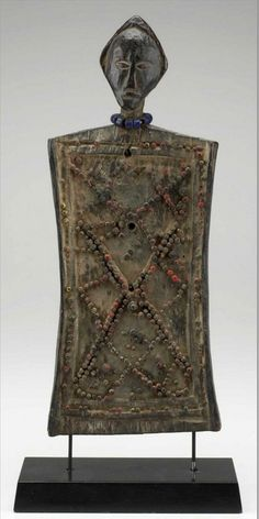 Africa | Memory board ~ lukasa ~ from the Luba people of DR Congo | Mid 20th century | Wood, metal, glass beads and string || A lukasa was used as a memory aid to recall important information about specific kings, cultural heroes, and clan migrations in the Luba kingdom.