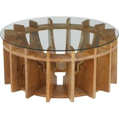 A distinctive centerpiece for your living room, this bold coffee table showcases a sundial-inspired wood base and glass top.Product: ...