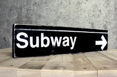 "New York City ""Subway"" Sign - Painted on Wood. $19.50, via Etsy."