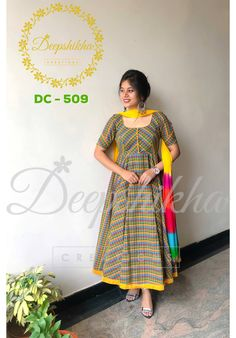 DC - 509. Beautiful yellow and blue color plaid floor length anarkali dress with yellow color net dupatta.For queries kindly WhatsApp: +91 9059683293  15 April 2018