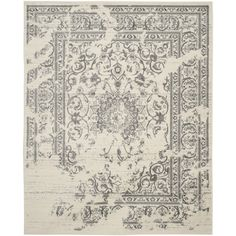 Featuring a stylish overdyed aesthetic, this 11' x 15' rug from Safavieh's Adirondack Collection makes a striking fashion statement in any room. Its ivory and silver color combination provides the per