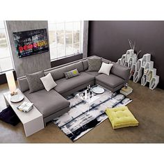 Perfect grey sectional with white end table and geometric shelves