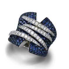 De Boulle Collection Overlap Ring with round blue sapphires with a zig-zag of diamonds.