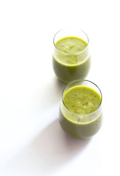 Peach Green Smoothie (Serves 2, 125 calories: 2 cups frozen peaches, 2 handfuls of spinach, 1 fresh peach, pitted and chopped (optional), 1 cup water, 1 T peeled, minced or grated fresh ginger, and 1 T honey + more to taste)