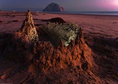 Sandcastle+on+Morro+Strand+State+Beach%2C+with+Morro+Rock+visible+in+background%2C+after+sunset+24+Aug+2009