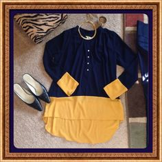 GIANNI BINI BLOUSE 100% polyester crepe high/Lo blouse with button placket front, no collar and contrast sleeve and bottom. Navy blue and sunset gold! Gianni Bini Tops Blouses
