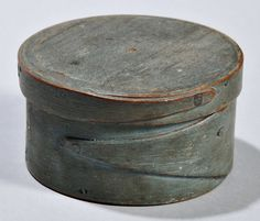Skinner's - The Personal Collection of Lewis Scranton, Auction 2897M. May 21, 2016. Lot: 189.  Estimate: $400-600.  Realized: $2,200.   Description:  Small Blue-painted Pantry Box, America, 19th century, round, with fingered seam, ht. 1 3/4, dia. 3 in.   Provenance: Ron & Penny Dionne, 1990.