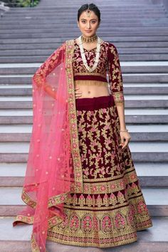 Wine velvet semi stitch lehenga with velvet choli. This Sweetheart neckline and Elbow Sleeves clothing designed with Resham, Dori and Stone work. Product are available in 32 to 58 sizes. It is perfect for Bridal Wear. Lehenga Choli Latest, Lehenga Choli Online, Bridal Lehenga Choli, Indian Lehenga, Maroon Wedding, Wedding Wear, Wedding Dresses, Lehenga Indien, Party Wear Lehenga