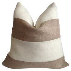 Bring a pop of style to your sofa or favorite reading nook with this eco-friendly burlap pillow, featuring a feather-down fill and natural and cream-hued str...
