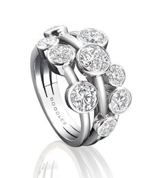 <p>A contemporary, stylish diamond ring from Boodles' Raindance collection</p> <ul> <li>Set with a central 0.70ct round-brilliant cut diamonds</li> <li>With a further 2.24ct of round-brilliant cut diamonds</li> <li>In platinum</li> </ul> <p>Width: 13mm (approx.).</p>