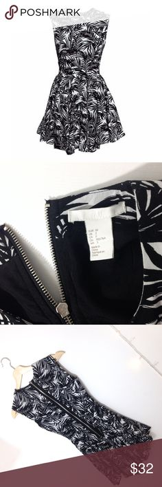 Palm Print Mini Dress Adorable flare fit Palm mini dress by HM, size 2 but would best fit a 0. Worn once in perfect condition. Black and white palm print with a long zip in the back. Fitted and flattering! H&M Dresses Mini