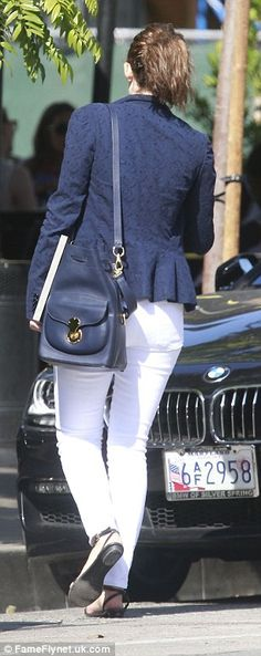 Keeping it casual:The TV star wore a grey tee tucked into her skinnies and ditching her high heel shoes
