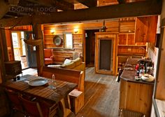 All 4 cabins have a spacious living area with attached a dining & kitchen Luxury Cabin, Gold Cup, Cozy Cabin, Rustic Design, Living Area, Liquor Cabinet, Kitchen Dining, Dining Table, Cabins