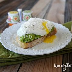 Avocado Egg Toasts from UnrulyBliss.com..... Except I used half the avocado for two slices of bread.