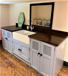 This beautiful 'double Belfast ' sink unit has everything you need for the perfect Laundry station.....the two deep double cupboards actually contain a  freestanding washing machine and tumble dryer With the added bonus of a  huge double Belfast sink  - with which you'll wonder how you ever managed without! Our solid pine unit has been painted in 'Lulworth Blue'  (Farrow and Ball) with a super smart ebonised worktop and  added upstand with ebonised handles on the doors to match.