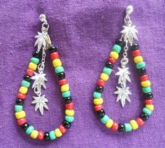 Ready for the Reggae show!?! These awesome Rasta hoop earrings give tribute to our beloved Jamaica sporting the traditional colors of their island! Dangling silver chains with tiny marijuana charms give them that extra special ganja look.  Handcrafted here at Mountain High Pharms LLC