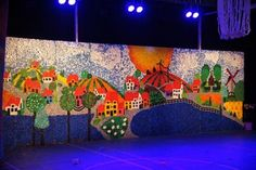 "Bottle cap mural ,made in 2014 by Eco artist Agnes Janssens .It contains 68000 bottle caps. This is the decor for the  schoolmusical ""Asseploeter"" by the primary school De Kriebel in Olen Belgium. ..."