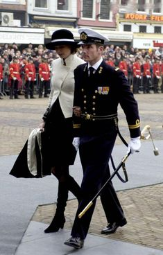 Prince Maurits of Orange-Nassau in the Netherlands Navy uniform and Princess Marilène at the funeral of prince Bernhard in December 2004.