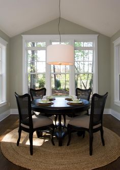 Benjamin Moore Prescott Green Dining Room with drum chandelier, dark small round table with circular RUG