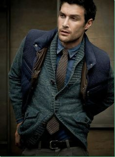 Try pairing a charcoal shawl cardigan with charcoal chinos if you're going for a neat, stylish look.  Shop this look for $158:  http://lookastic.com/men/looks/denim-shirt-tie-waistcoat-belt-chinos-shawl-cardigan/4545  — Navy Denim Shirt  — Dark Brown Polka Dot Tie  — Navy Quilted Waistcoat  — Black Leather Belt  — Charcoal Chinos  — Charcoal Shawl Cardigan