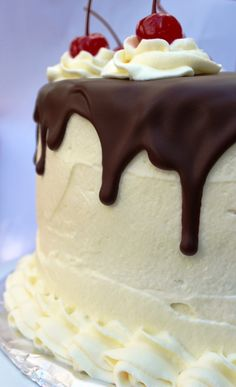 Banana Split Layer Cake - layers of banana, strawberry, and chocolate cake with whipped cream frosting and bittersweet chocolate ganache
