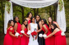 Gorgeous girls in full-length red bridesmaids dresses