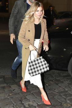 February 15, 2017  Who: Sienna Miller  What: A Plaid Bag  Why: Miller was ladylike chic in a pencil skirt, camel coat and red heels, all finished with a statement-making yet demure black and white plaid bag.  Get the look now: Mansur Gavriel bag, mansurgavriel.com.