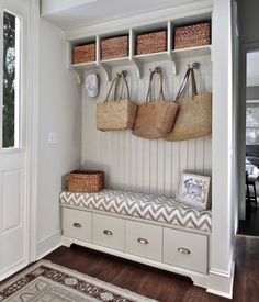 Great use of space for a cute entry way/mud room