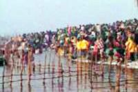 Thousands of devotees took holy dip in the river Ganges at the ongoing Kumbh Mela, on the occasion of Magh Purnima on Monday.  The holy dip began in early morning hours at around 4.00 am and swarms of people continued to come in batches for the royal bath.  Special security arrangements were made on the premises of the Mela and policemen stepped up the vigil in the aftermath of the recent twin bomb blasts in Hyderabad.