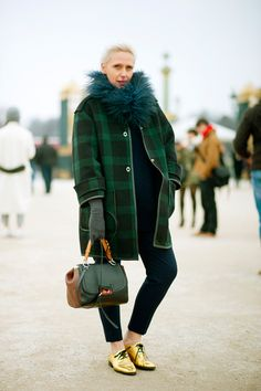 Parisians love monochrome, even in dark green! You will rarely seem them wear head to toe in bright colors, though.