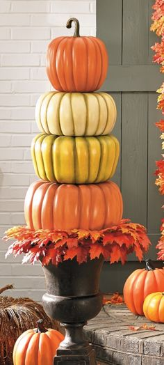 Give them a warm fall welcome with our everlasting All-weather Pumpkin Topiaries.