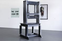"""Rupert Norfolk, Guillotine, 2007; Monica Bonvicini, Bet Your Sweet Life, 2010; Richard Hawkins, Disembodied Zombie George White, 1997. """"The Crime Was Almost Perfect"""", Witte de With Center for Contemporary Art, Rotterdam 2014, photo by Aad Hoogendoorn"""