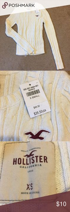 Extra small Hollister cableknit cream sweater NWT NWT cream cableknit sweater.  Size extra small Hollister Sweaters Crew & Scoop Necks