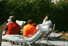 Elvis and Priscilla Presley lounge by the pool with friends and relatives at their Ladera Circle home in Palm Springs, CA, May 2, 1967.